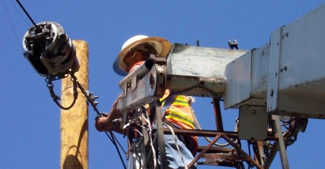 Harris-McBurney linemen working installing a pwer line