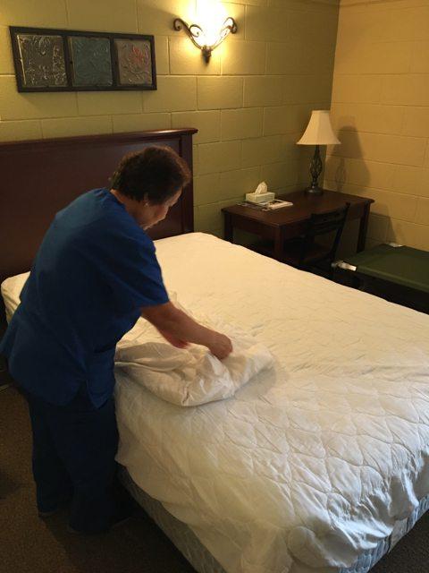 HME Inc housekeeper cleaning room