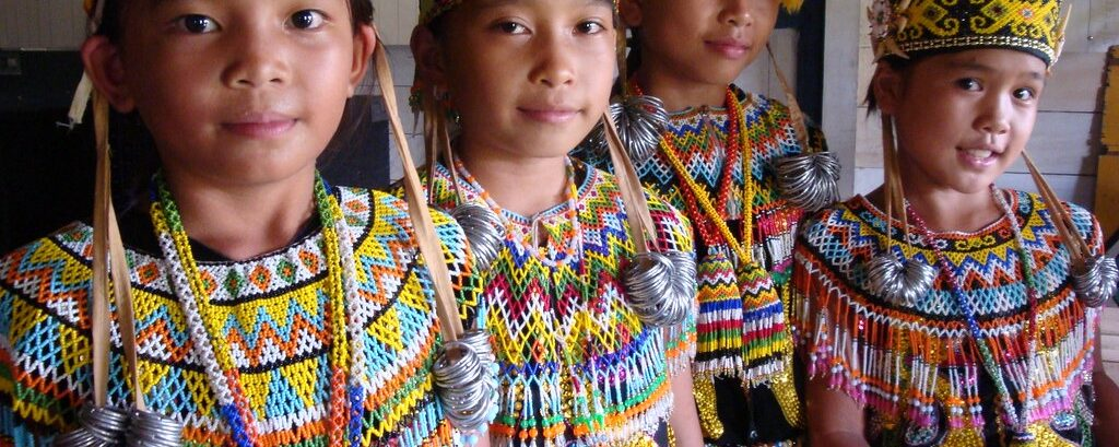 Dayak And Hmong: Beads into Their Clothing and Design on Their Hats