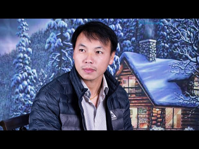 Singing by Nkauj Ntxhee Xyooj. Music by Billy Xiong. Hmong Production.