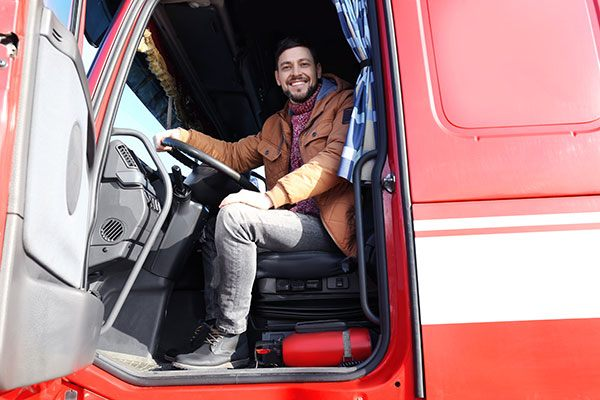 driver in red truck smiling