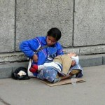 Picture about Begging Gangs Hire Babies and Drug them to Sleep