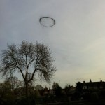 Picture about Mysterious Black Ring Hovering Over Sky in England