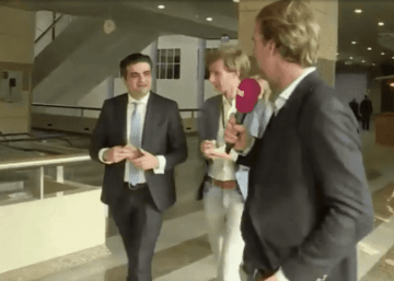 Picture Suggesting Dutch Politician Tunahan Kuzu Puts a Grilled Cheese Sandwich in his Pocket Before an Interview