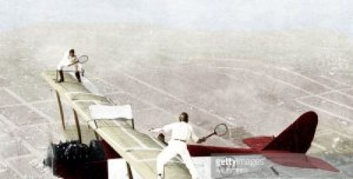Colored Getty Image: Two Daredevils Playing Tennis on Flying Airplane Wings