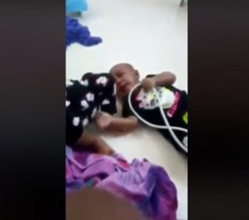 Image of Twin girls beaten badly and thrown on ground