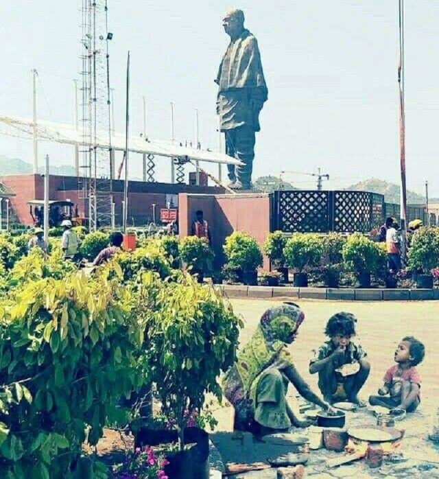 Image about Homeless Family Cooking Food Near Statue of Unity