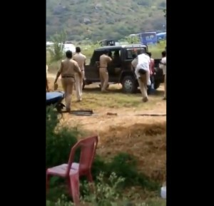 Image of Police taking farmer Kotaiah to hospital in Van
