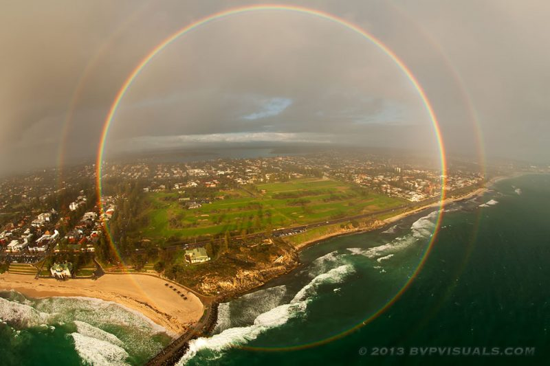 Image of Full circle rainbow captured over Cottesloe Beach near Perth, Australia in 2013 by Colin Leonhardt of Birdseye View Photography.