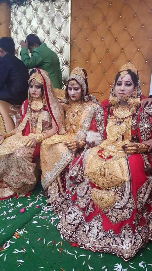 Image of three women loaded with jewellery