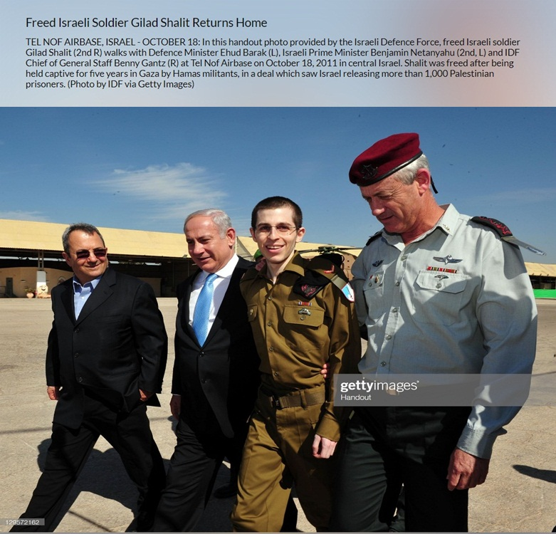 Image of Freed Israeli soldier Gilad Shalit walks with the Prime Minister and others