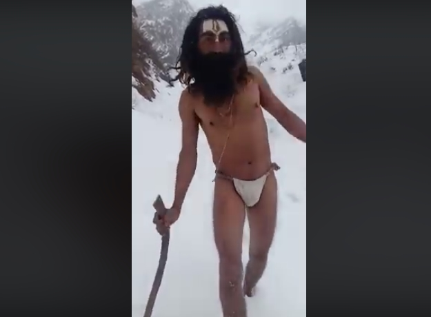 Image of The Sadhu Praying in Ice Cold Temperature