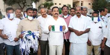 Image about YSRCP People Distributing Masks Carrying Party Flags