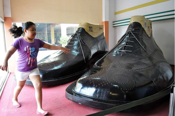 Image of A pair of the giant shoe replica displayed at a mall in Marikina City