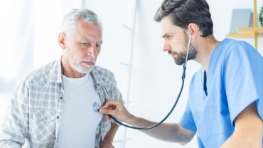 Doctor is checking the old man.