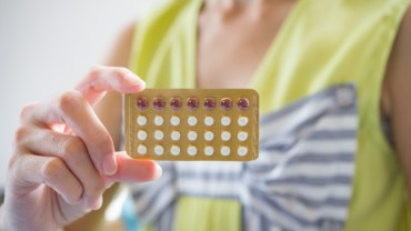 woman holding a contraceptive panel