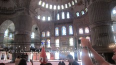 The majestic interior of the massively hollow Blue Mosque