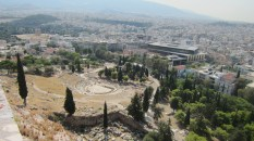 That's the Theater of Dionysus, and the New Acropolis Museum behind it