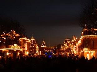 Main Street all lit up and mobbed