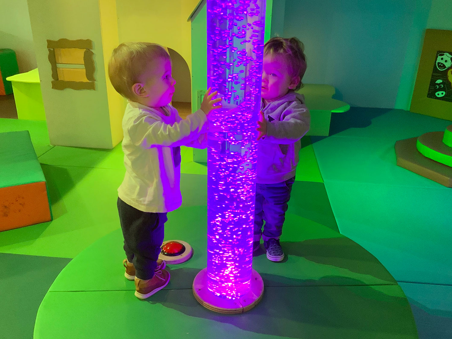 Two children at a bubble tube