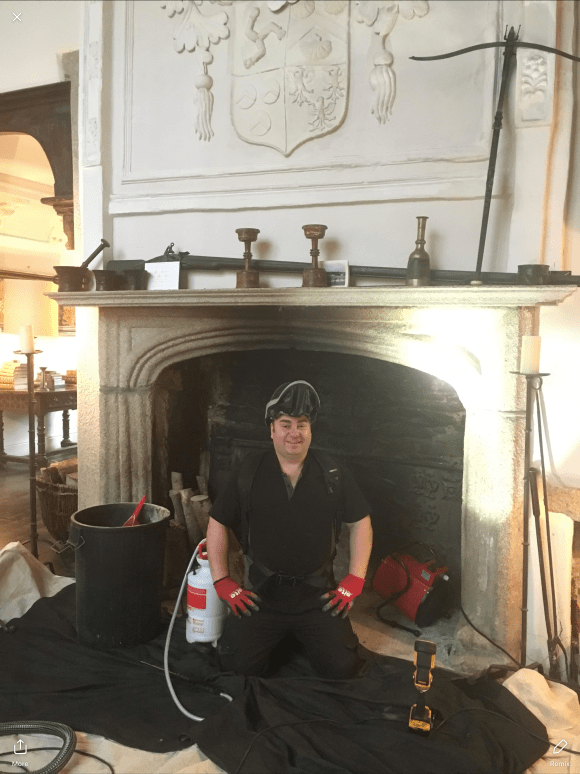Mr Daniel Hodgson, Sweep Safe Certified Chimney Sweep, preparing the opening ready for a Creaway Treatment in Tavistock, Devon.