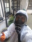 Mr Danny Hodgson of Hodgsons Chimney Sweeps wearing 3m TR619E ASB Respirstor and 3m 7900pf mask, with nitrile gloves and asbestos grade overalls