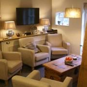 huiskamer met tv groepsaccommodatie hoestinkhof
