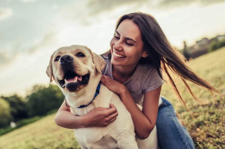 Very cheerful girl with her dog