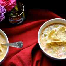 Velvety Mexican Potato Soup is a bowl of comfort made with fire-roasted tomatoes, garlic, and onions and lots and lots of melty Monterey Jack cheese. #mexicanpotatosoup #mexicancheesesoup #vegetarianmexicansoup #cheesepotatosoup
