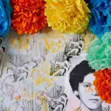 Colorful tissue paper flowers decorating an altar for Day of the Dead