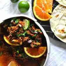 This slow cooker chilorio recipe tastes like the authentic Mexican dish of pork with chiles and orange but with half the work thanks to the slow cooker.