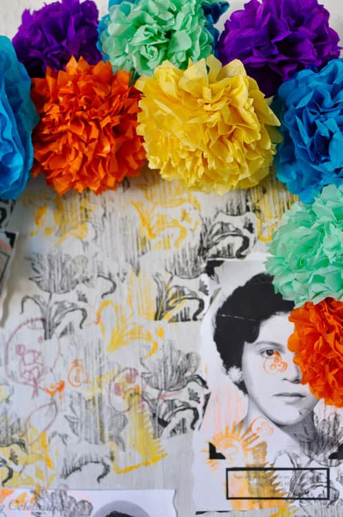 Paper Flowers decorating a Day of the Dead altar with a woman's photo on it.