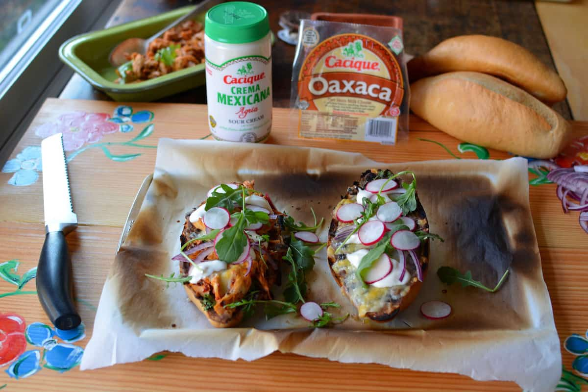Easy as can be, this recipe for Smoky Chipotle Turkey Tortas uses leftover holiday turkey or rotisserie chicken and is ready in 30 minutes. With refried black beans, Oaxaca cheese, and a fresh sprinkle of arugula and radishes this Mexican-style sandwich is the prefect weeknight meal. #tortas #tortasmexicanas #tortasmexicanasrecipe
