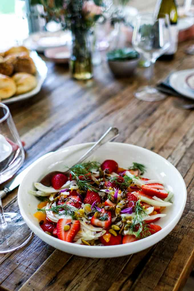 This winter fruit salad is a gorgeous combination of thinly sliced fennel, juicy strawberries, and floral clementines tossed in a lemon and honey dressing and sprinkled with roasted pistachios. #fruitsalad #brunchrecipe #fruitsaladrecipe