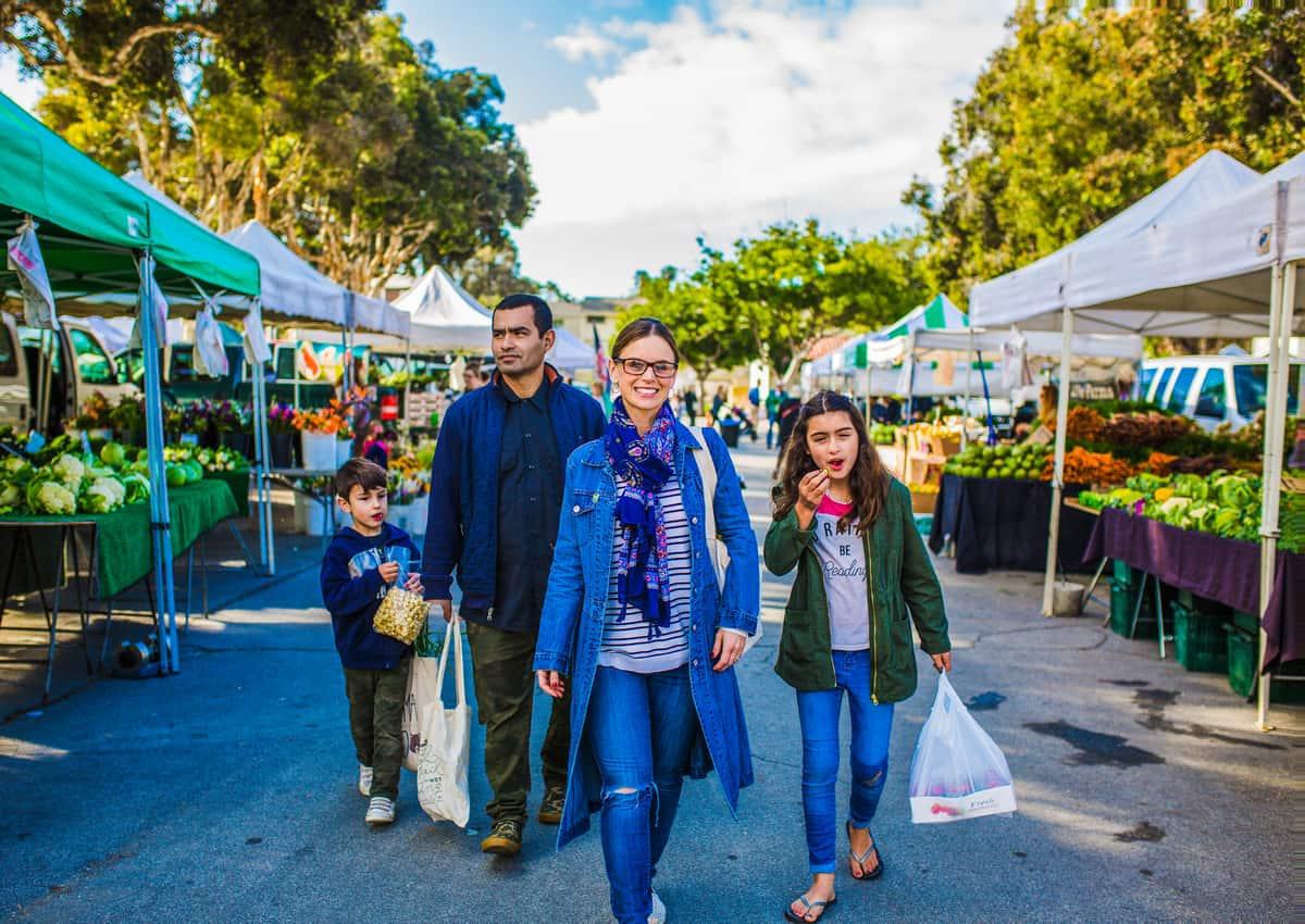 Family walking in a Farmer's Market.