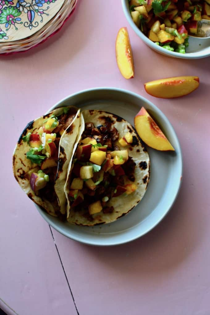 These Chili Lime Chicken Tacos will become your newest summer supper staple. They are packed with flavor and topped with a fresh peach pico de gallo. Best part? They'll be ready in 30 minutes! #chickentacos #healthytacosrecipe #peaches #chicken #tacos #healthyMexicanrecipe