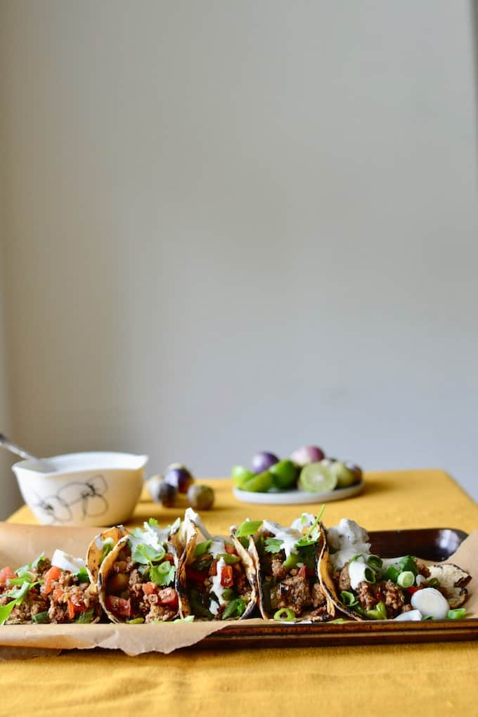 Chiles en Nogada tacos wrap everything we love about the Mexican Independence Day dish—tender meat, pomegranate seeds, walnut sauce—up in a warm tortilla. #chilesennogada #tacos #groundbeef #MexicanIndependenceday #september16