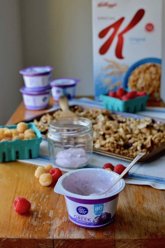 This super simple granola recipe {#ad} is made right on the stove top in under 10 minutes. It has almonds, oats, a bit of ginger, and Kellog's Special K cereal to make it extra crisp. Layer with Greek yogurt and fresh berries for a healthy breakfast when you need something fast. #granola #easygranola #yogurt #yogurtparfait #easybreakfast #healthybreakfast