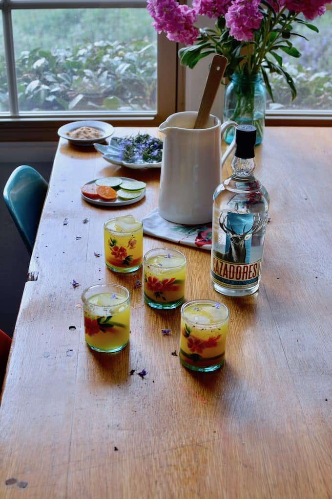 Three ingredients is all you need to make these Pitcher-Perfect Sour Orange Margaritas. Making them the easiest, most refreshing margaritas fit for a crowd. #pitchermargaritas #margaritas #margaritarecipe #easymargaritas #margaritasforacrowd