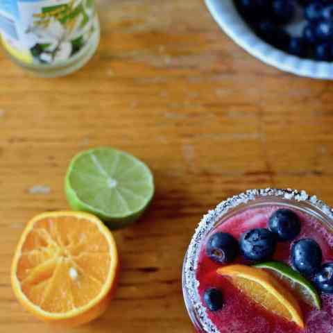 There are a 101 ways to enjoy blueberries but a Blueberry Rose Margarita has got to be my favorite. A splash of rose water adds the perfect floral touch. #blueberrymargarita #margarita #blueberries #margaritarecipe