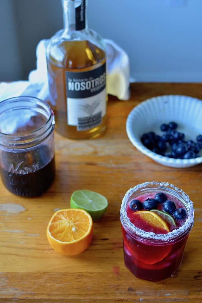 There are a 101 ways to enjoy blueberries but a Blueberry Rose Margarita has got to be my favorite. A splash of rose water adds the perfect floral touch. #margarita #blueberrymargarita #blueberries #margaritarecipe #rosewater