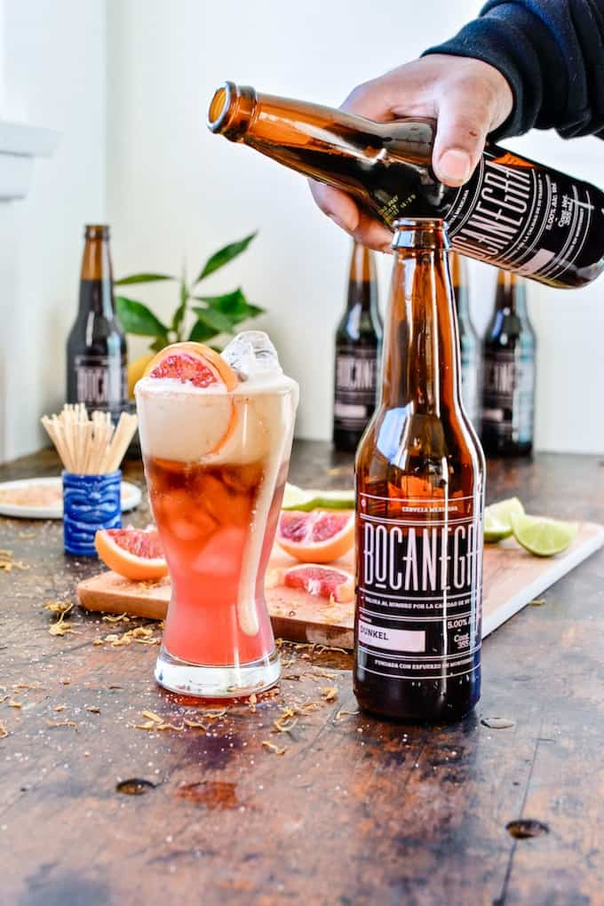 This Blood Orange Beergarita has everything you love about margaritas topped with bubbly beer. Perfect for the Super Bowl! #holajalapeno #superbowl #beergarita #beercocktails