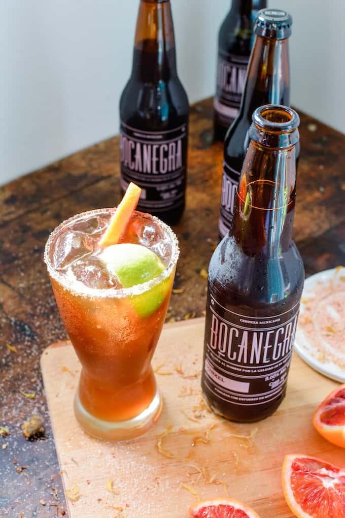How to make the most bomb beer cocktail: A Blood Orange Beergarita. Blood orange juice, tequila, beer, with a chili-salt rim. #holajalapeno #beergarita #superbowl