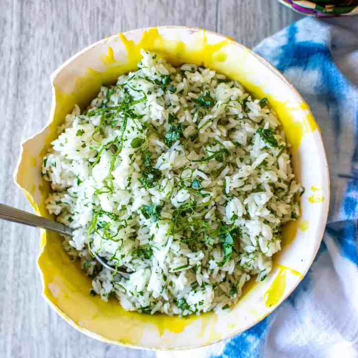 Here's a simple recipe for Cilantro Lime Rice with stove top and rice cooker instructions included, using jasmine rice, fresh limes, fresh cilantro, and olive oil. Use it to make burrito bowls or as a side dish for your favorite Mexican meal. #cilantrolimerice #ricerecipe #mexicansidedish #cilantrorice