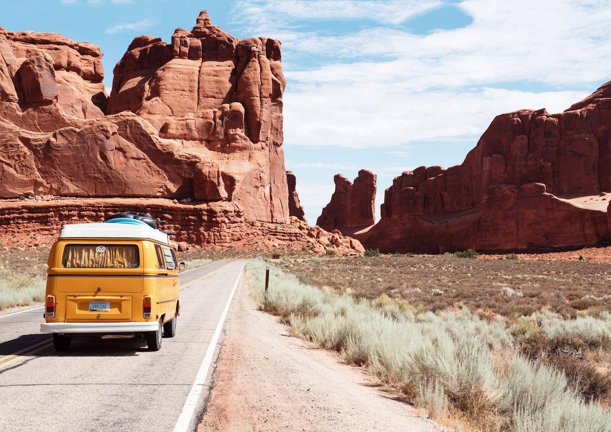vintage van driving through the desert