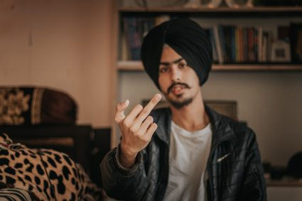 Guy giving middle finger