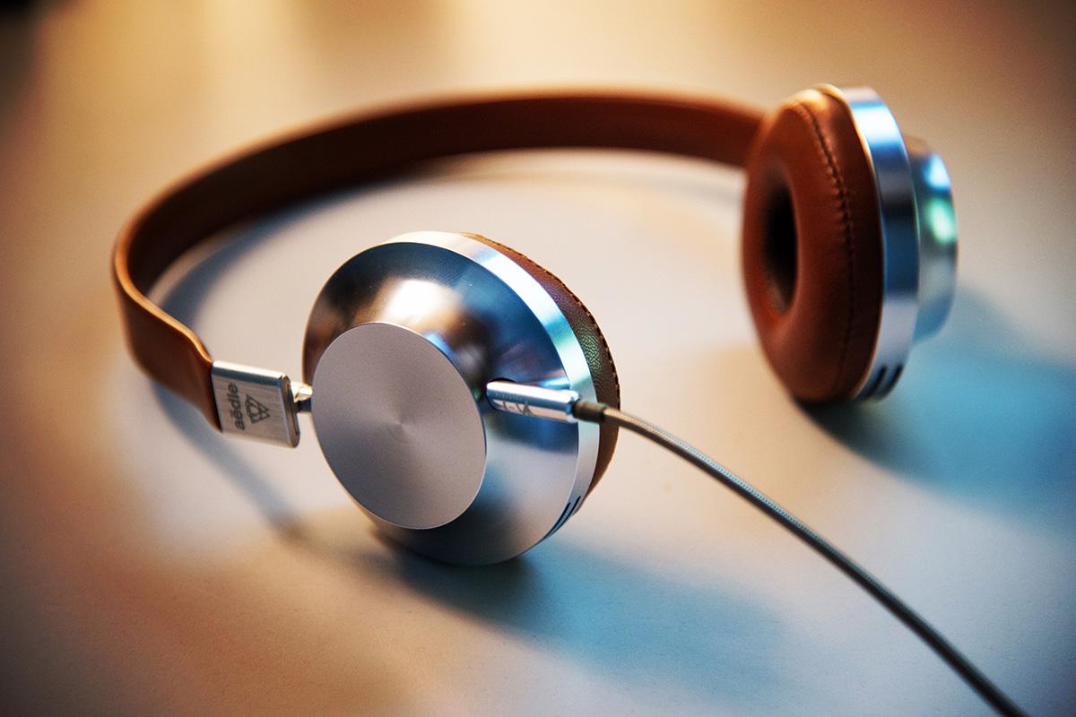 pair of headphones resting on desk