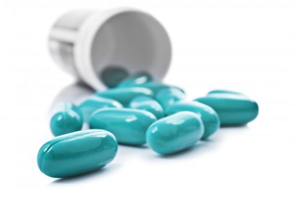 blue pills e1484420475935 Stomach acid suppressing meds causing infections and serious health problems