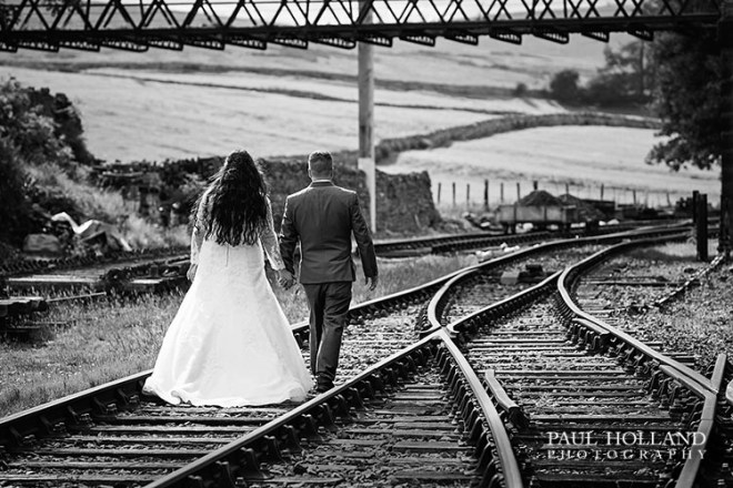 Image showing bride and groom on the railway tracks at Kirkby Stephen East Railway Station