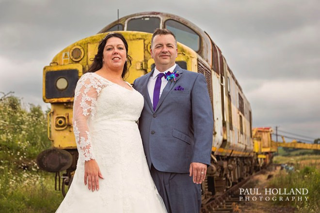 Image showing the bride and groom with a 1962 locomotive